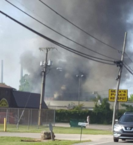 Smoke billows into the air from a fire at the Rock Branch Industrial Park. (Photo Courtesy of Samantha Cart)