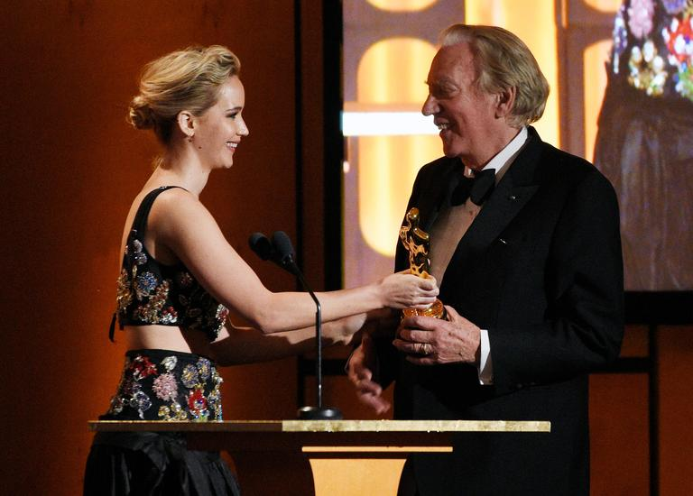 Actress Jennifer Lawrence, left, presents an honorary Oscar to actor Donald Sutherland at the 2017 Governors Awards at The Ray Dolby Ballroom on Saturday, Nov. 11, 2017, in Los Angeles. (Photo by Chris Pizzello/Invision/AP)