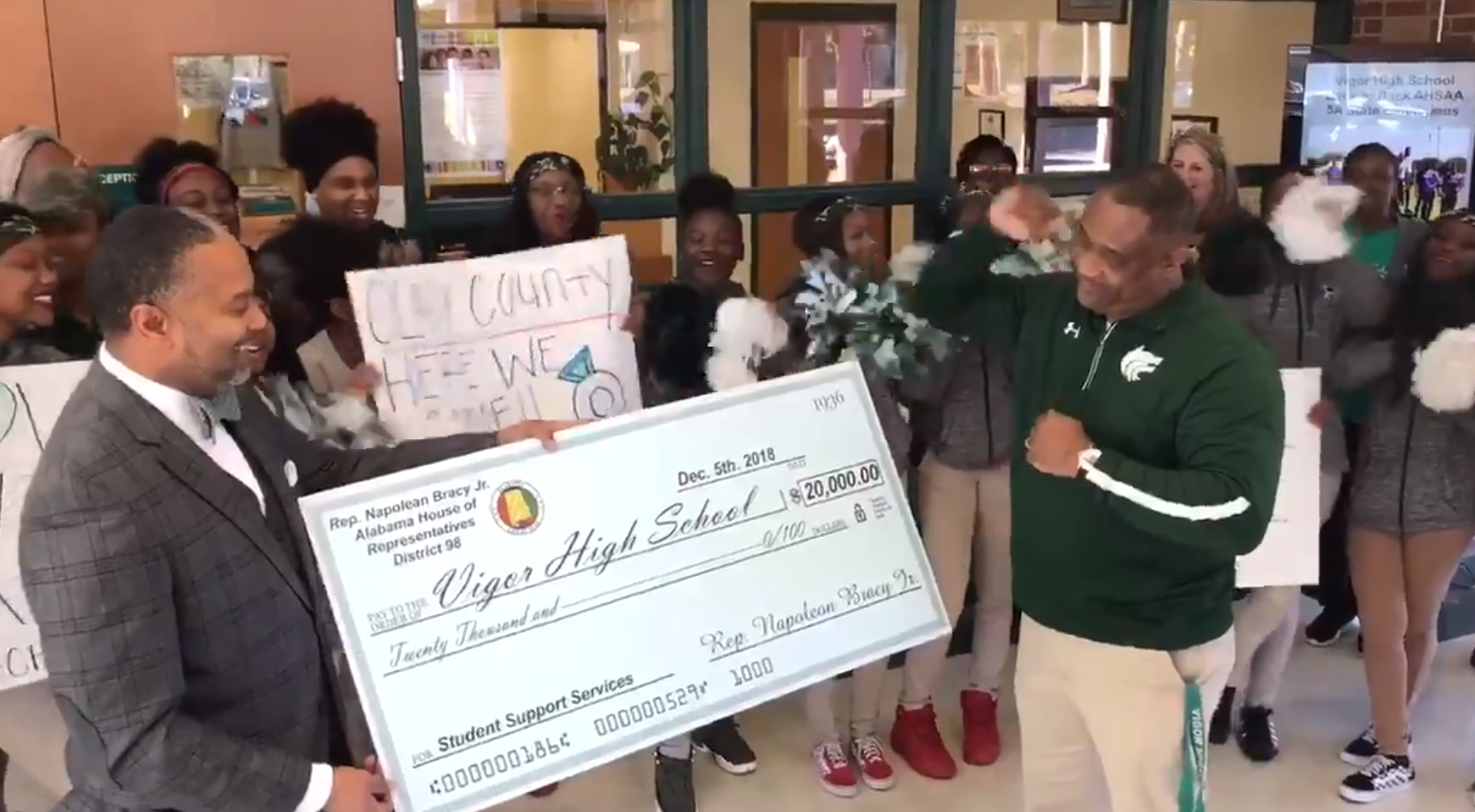 (image: WPMI) Napoleon Bracy donates $20,000 to Vigor High School
