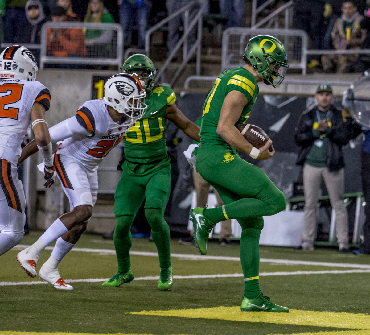 Oregon quarterback Justin Herbert (10) runs the ball for a touchdown. The Oregon Ducks lead the Oregon State Beavers 52 to 7 at the end of the first half of the 121st Civil War game on Saturday, November 25, 2017 at Autzen Stadium in Eugene, Ore. Photo by Ben Lonergan, Oregon News Lab