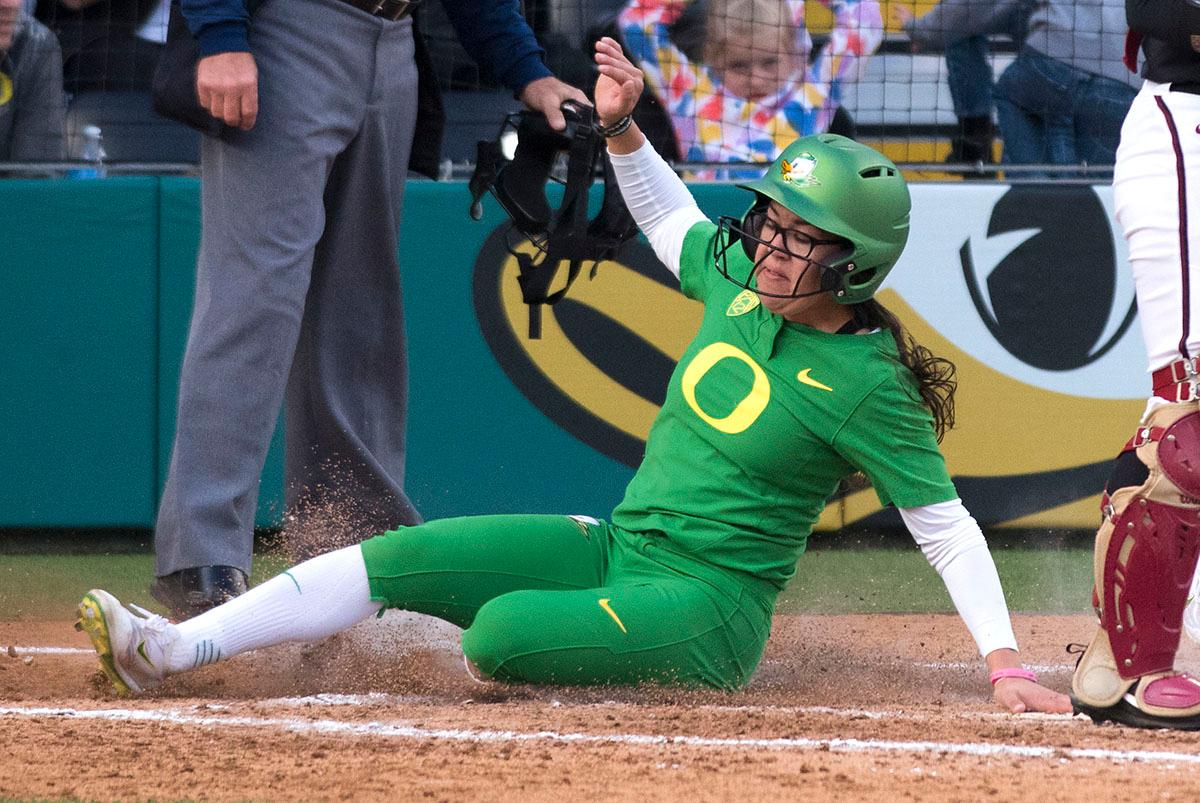 Oregon Ducks right fielder Danica Mercado (#2) slides into home plate. The No. 5 Oregon Ducks defeated the No. 2 Florida State Seminoles in both games of the doubleheader (11-0, 3-1) on Saturday afternoon. This sweep of the first two rounds of the postseason happened in front of a soldout crowd of 2,517 at Jane Sanders Stadium. Photo by Cheyenne Thorpe, Oregon News Lab