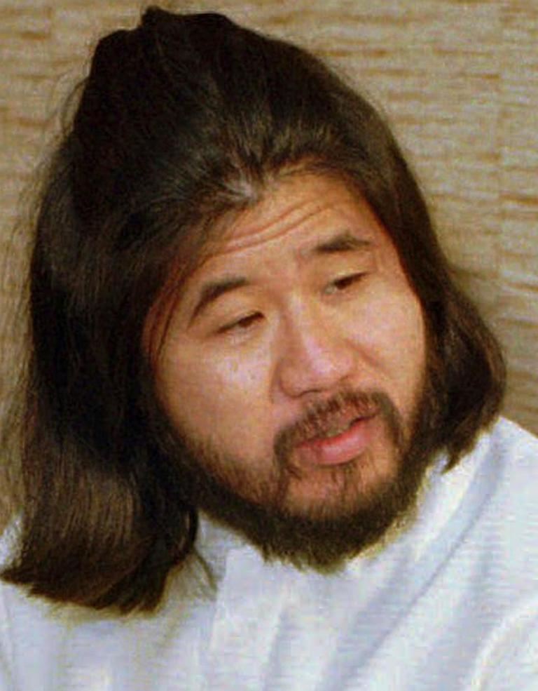 FILE - This Nov. 30, 1989, file photo shows Japanese doomsday cult leader Shoko Asahara in Bonn, Germany. Japanese media reports say on Friday, July 6, 2018, Asahara, who has been on death row for masterminding the 1995 deadly Tokyo subway gassing and other crimes, has been executed. He was 63. (AP Photo/Roberto Pfeil, File)