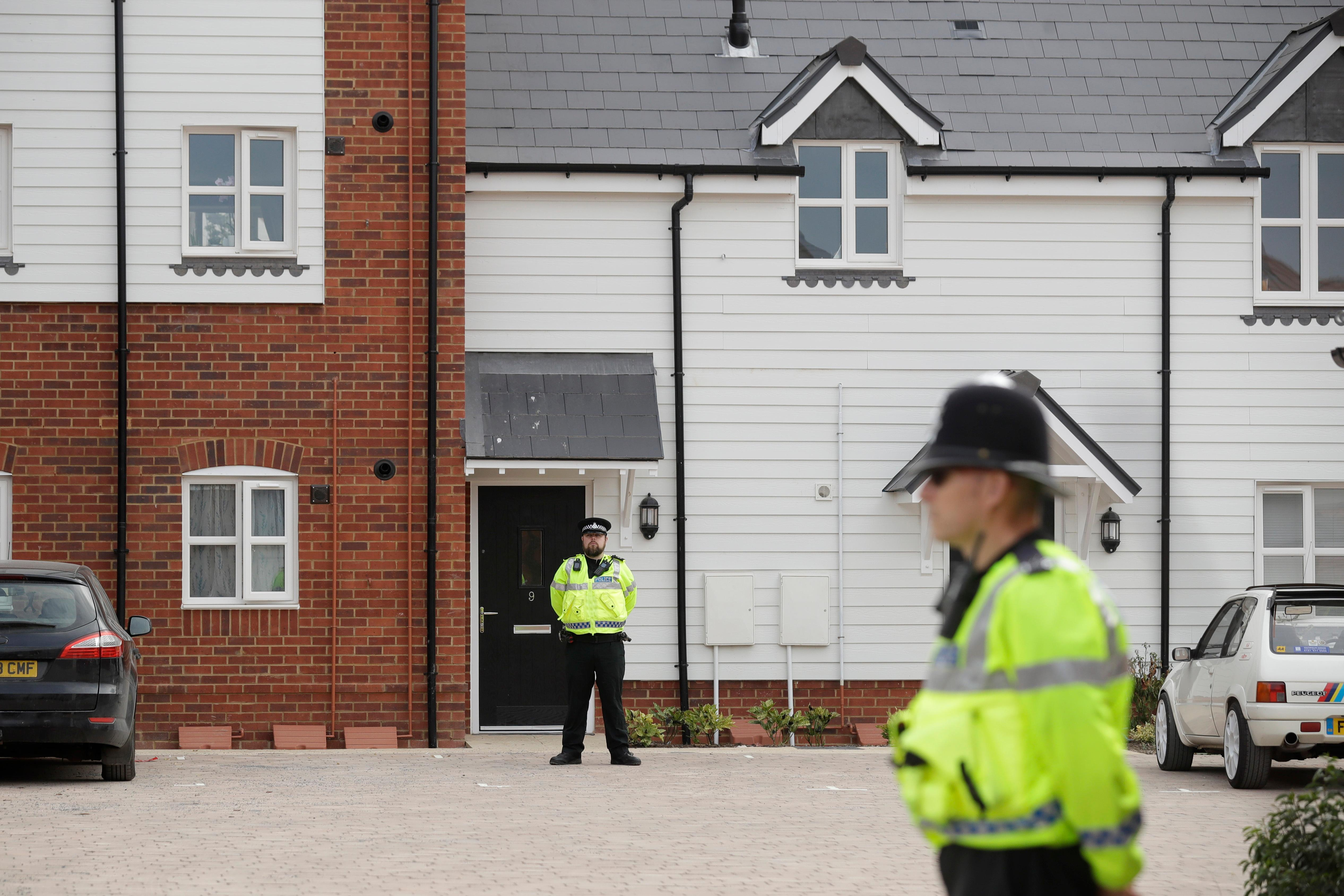 British police officers stand outside a residential property in Amesbury, England, Wednesday, July 4, 2018.  (AP Photo/Matt Dunham)
