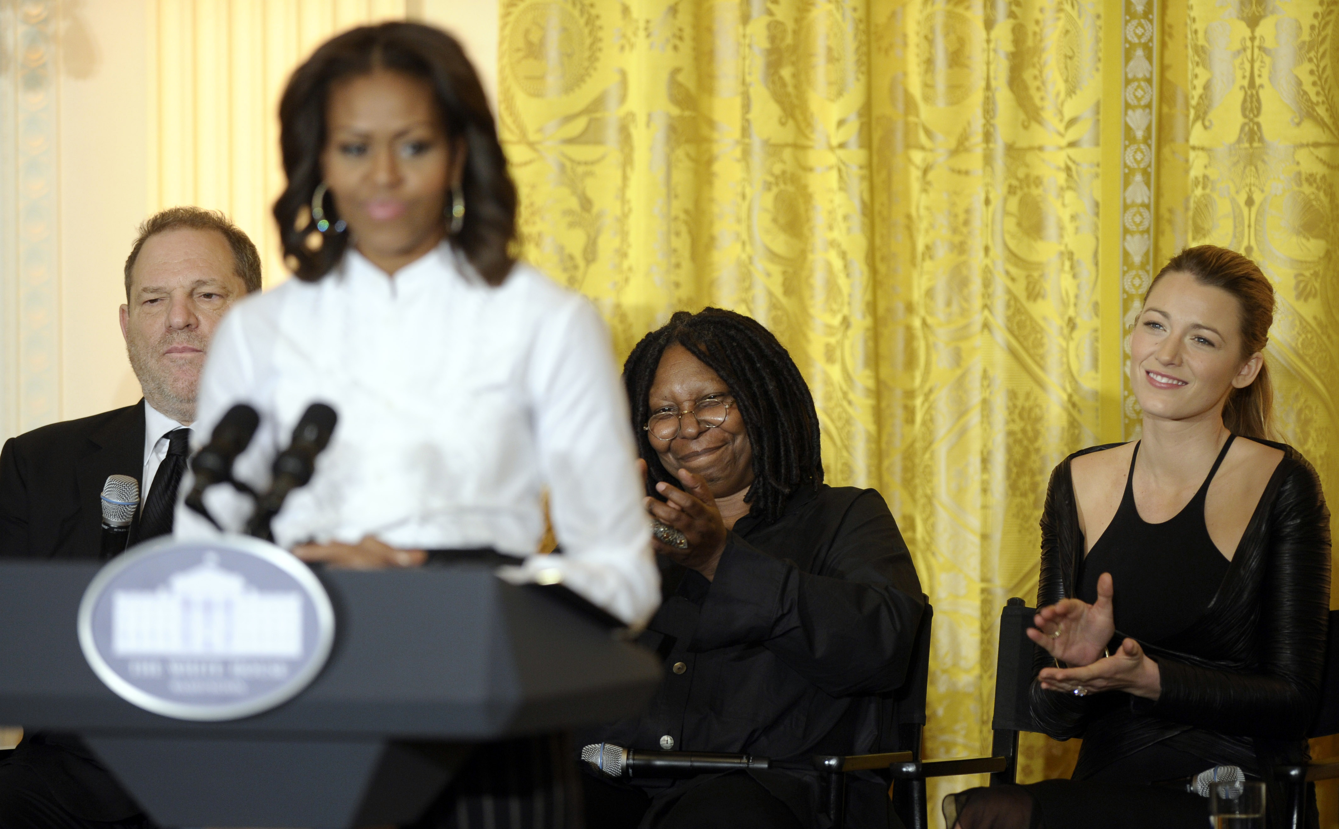 FILE - In this Nov. 8, 2013, file photo, movie mogul Harvey Weinstein, left, Oscar-winning actress Whoopie Goldberg, second from right, and actress Blake Lively, right, listen to then-first lady Michelle Obama as she speaks in the East Room of the White House in Washington, at a workshop for high school students about careers in film. Congressional Democrats are starting to give charities thousands of dollars that Weinstein contributed to them over the years. The nonpartisan Center for Responsive Politics says Weinstein has donated more than $1.4 million since the 1992 election cycle. Nearly all has gone to Democrats and their allies.  (AP Photo/Susan Walsh, File)