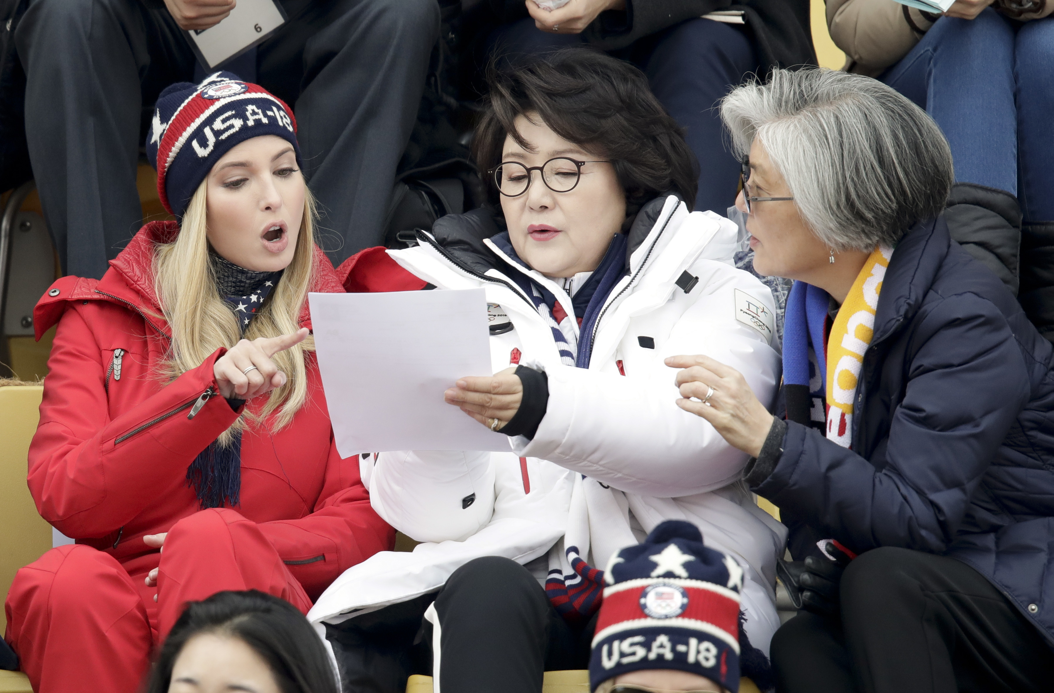 Ivanka Trump, left, talks with Kim Jung-sook, wife of the South Korean President and South Korean Foreign Minister Kang Kyung-wha, right, during the men's Big Air snowboard competition at the 2018 Winter Olympics in Pyeongchang, South Korea, Saturday, Feb. 24, 2018. (AP Photo/Dmitri Lovetsky)