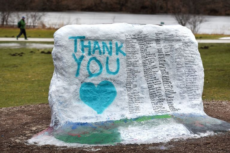 "This Thursday, Jan. 25, 2018 photo shows The Rock on Michigan State University's campus which was painted  ""Thank You"" and and includes the names of the women who gave victim impact statements during the Larry Nassar sentencing hearing in East Lansing, Mich. Nassar is on his way to prison for the rest of his life for molesting scores of young female athletes, but the scandal is far from over at Michigan State University as victims, lawmakers and a judge demand to know why he wasn't stopped years ago.  (Nick King/Lansing State Journal via AP)"