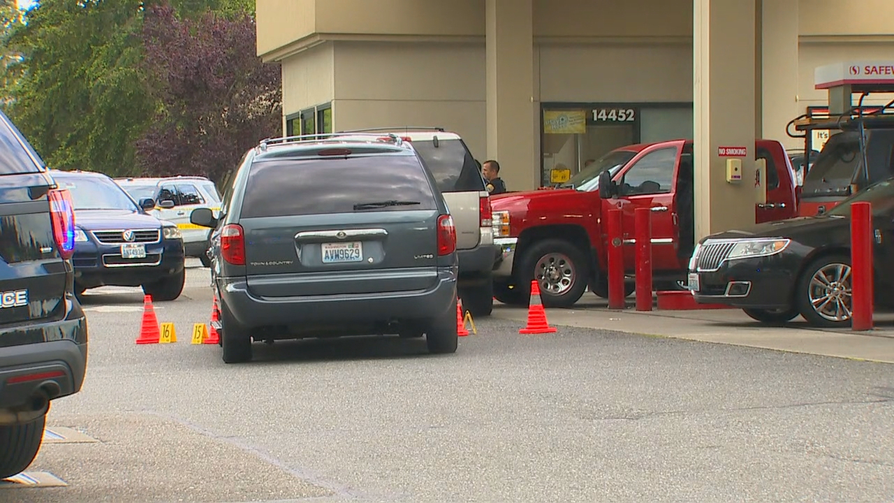 Detectives investigate after a man was shot at killed by Redmond Police officers at a Safeway gas station in Kirkland on Thursday, June 14, 2018. (Photo: KOMO News)