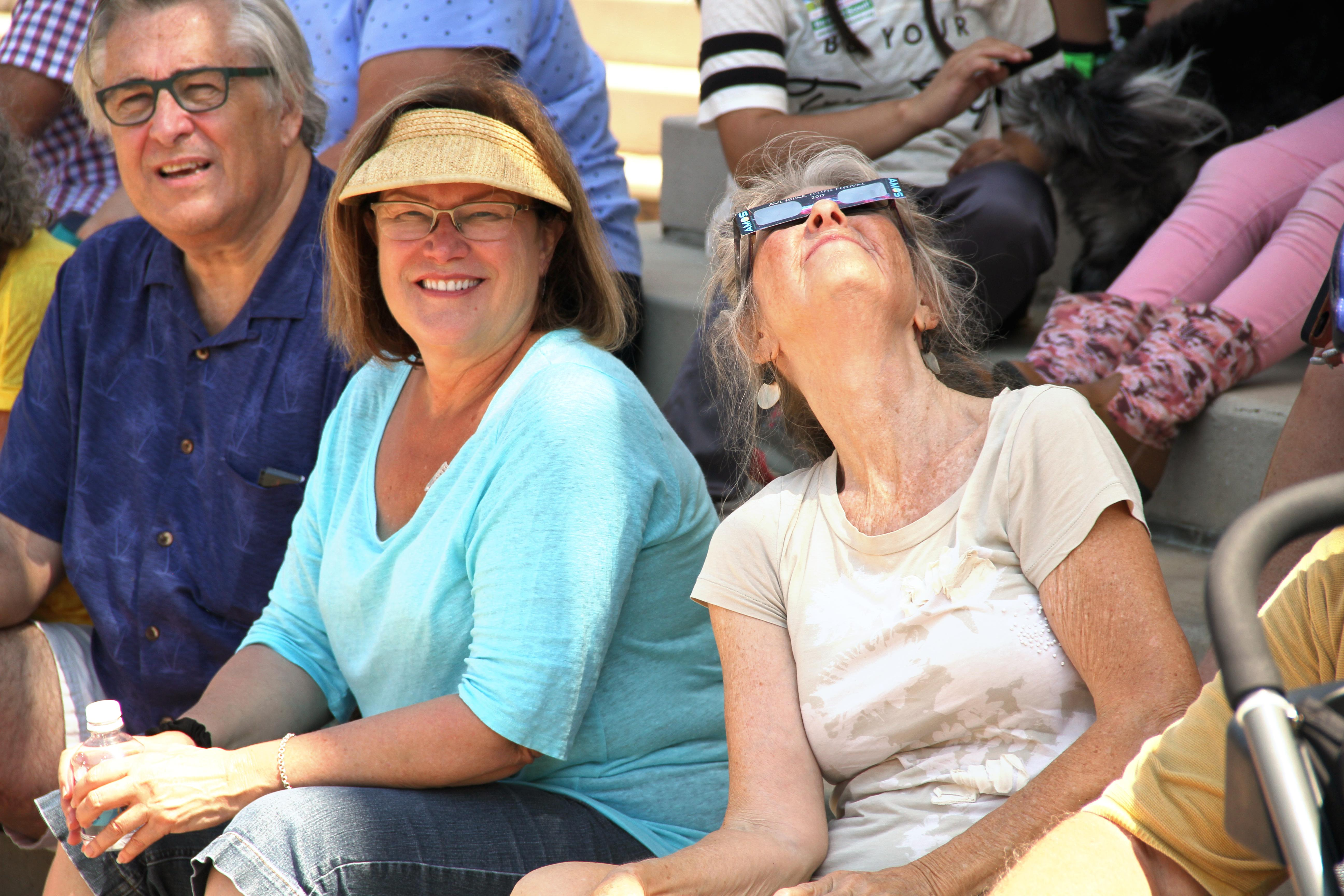 Thousands gathered in Pack Square Park in downtown Asheville for the Solar Eclipse Festival on August 21, 2017. Asheville experienced 99.2 percent obscuration at the peak of this eclipse. During peak, the temperature dropped, street lights came on and the sounds of crickets chirping could be heard. (Photo credit: WLOS Staff)